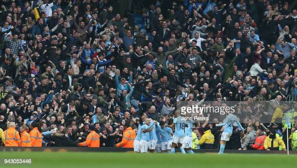Vincent Kompany of Manchester City celebrates scoring their first goal during the Premier League match between Manchester City and Manchester United...