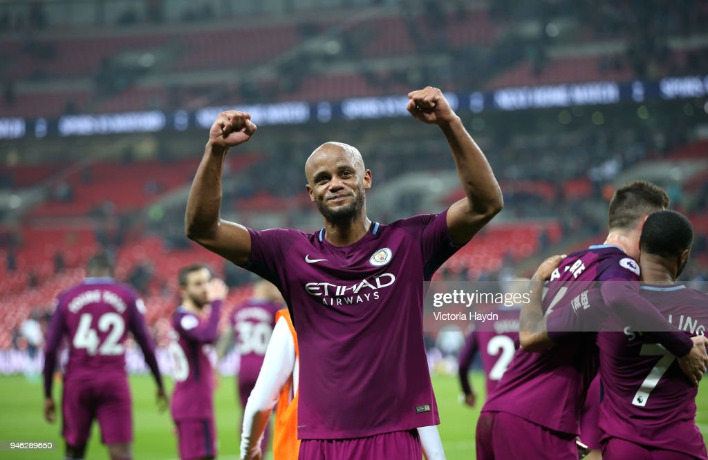 Vincent Kompany of Manchester City celebrates victory after the Premier League match between Tottenham Hotspur and Manchester City at Wembley Stadium on April 14, 2018 in London, England.