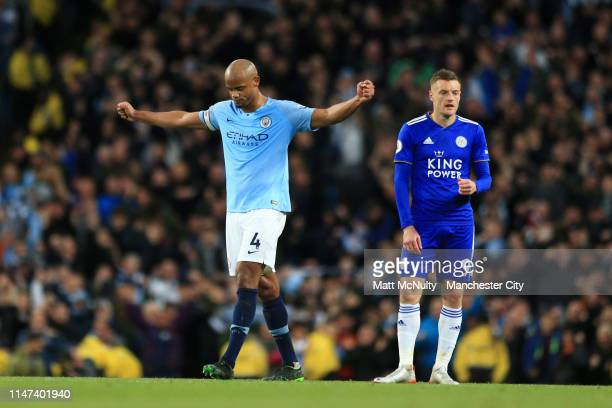 Vincent Kompany of Manchester City celebrates victory as Jamie Vardy of Leicester City reacts after the Premier League match between Manchester City...