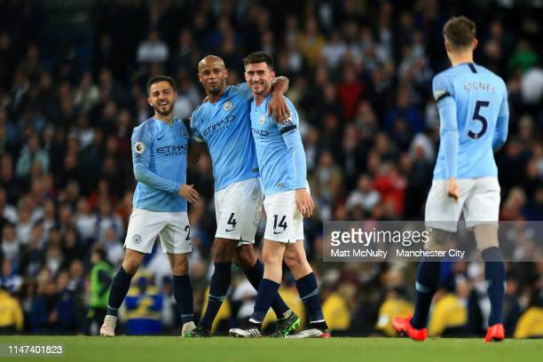 Vincent Kompany of Manchester City celebrates victory with Bernardo Silva of Manchester City and Aymeric Laporte of Manchester City during the...
