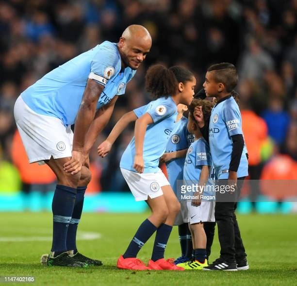 Vincent Kompany of Manchester City celebrates victory with his children during the Premier League match between Manchester City and Leicester City at...