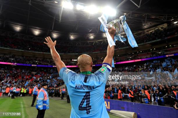 Vincent Kompany of Manchester City celebrates victory with the trophy after the Carabao Cup Final between Chelsea and Manchester City at Wembley...
