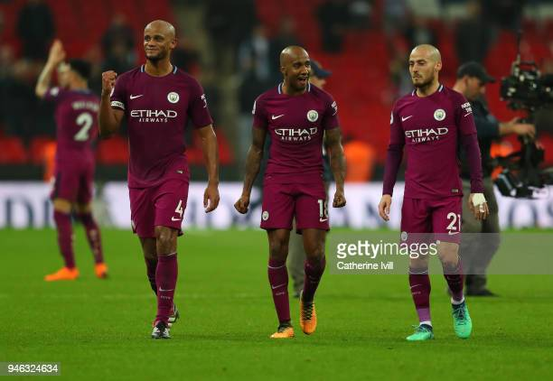 Vincent Kompany of Manchester City celebrates with Fabian Delph and David Silva of Manchester City after the Premier League match between Tottenham...