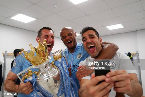 Vincent Kompany of Manchester City celebrates with the Premier League Trophy after winning the title following the Premier League match between...