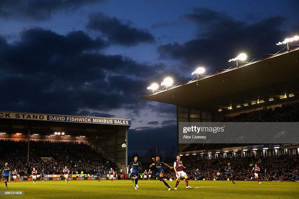 Vincent Kompany of Manchester City chases the ball during the Barclays Premier League match between Burnley and Manchester City at Turf Moor on March 14, 2015 in Burnley, England.