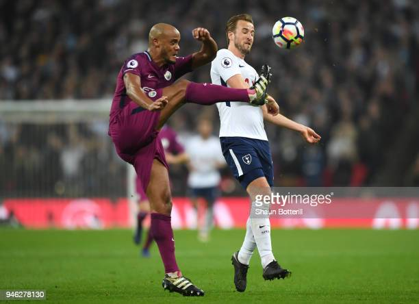 Vincent Kompany of Manchester City clears the ball from Harry Kane of Tottenham Hotspur during the Premier League match between Tottenham Hotspur and...