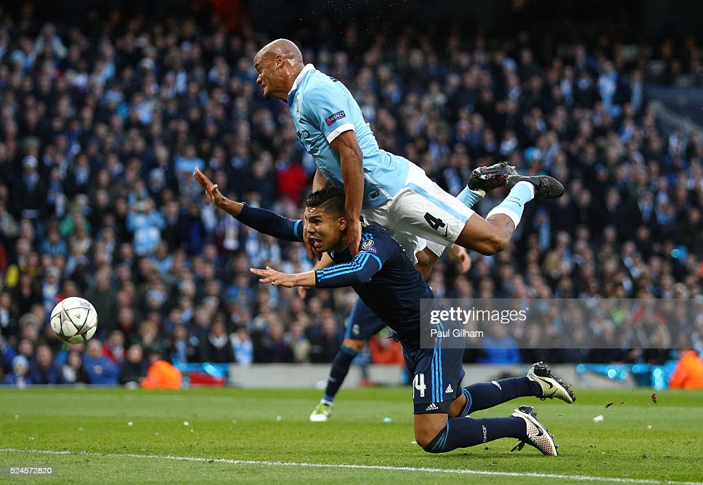 Vincent Kompany of Manchester City collides with Casemiro of Real Madrid CF during the UEFA Champions League Semi Final first leg match between Manchester City FC and Real Madrid at the Etihad Stadium on April 26, 2016 in Manchester, United Kingdom.