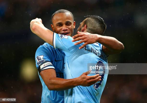 Vincent Kompany of Manchester City congratulates Alvaro Negredo of Manchester City on scoring his second goal during the Capital One Cup SemiFinal...