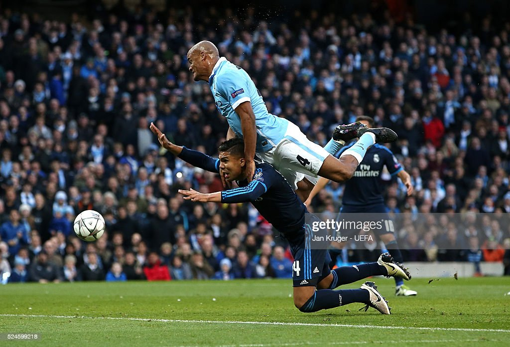 Vincent Kompany of Manchester City FC battles with Casemiro of Real Madrid during the UEFA Champions League semi final first leg match between Manchester City FC and Real Madrid on April 26, 2016 in Manchester, England.