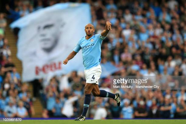 Vincent Kompany of Manchester City gives his team instructions infront of a banner for him during the Premier League match between Manchester City...