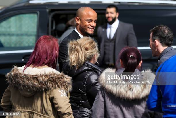 Vincent Kompany of Manchester City greets fans at the Funeral of Manchester City Life President Bernard Halford at St Mary's Church in Manchester on...