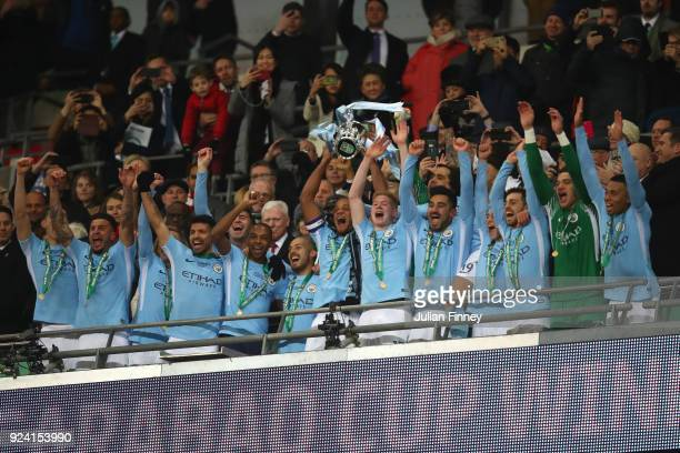 Vincent Kompany of Manchester City hold the trophy after winning the Carabao Cup Final between Arsenal and Manchester City at Wembley Stadium on...