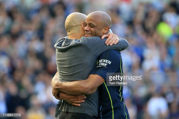 Vincent Kompany of Manchester City hugs Josep Guardiola, Manager of Manchester City during the Premier League match between Brighton & Hove Albion...