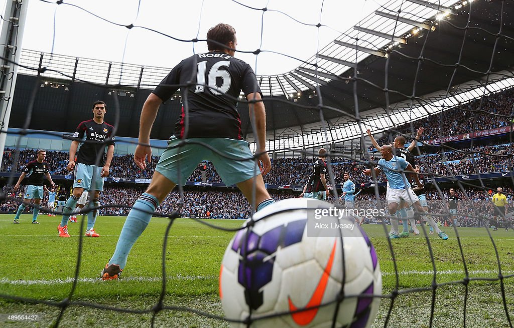 Vincent Kompany of Manchester City is celebrates after scoring the second goal during the Barclays Premier League match between Manchester City and West Ham United at the Etihad Stadium on May 11, 2014 in Manchester, England.