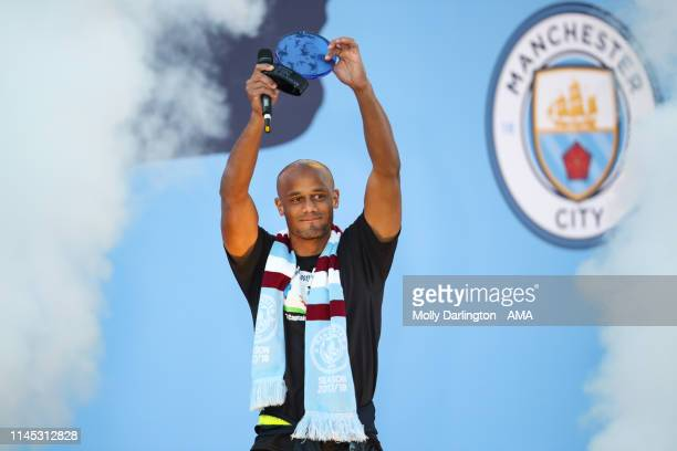 Vincent Kompany of Manchester City is rewarded goal of the season during the Manchester City trophy parade in Manchester on May 20 2019 in Manchester...