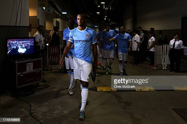 Vincent Kompany of Manchester City leads his team out to the pitch for the second half of the Barclays Asia Trophy Final match between Manchester...