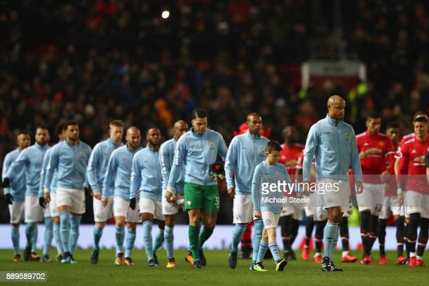 Vincent Kompany of Manchester City leads out his team during the Premier League match between Manchester United and Manchester City at Old Trafford...