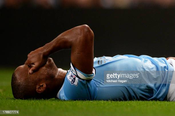 Vincent Kompany of Manchester City lies injured on the pitch after making a challenge on Sammy Ameobi of Newcastle United during the Barclays Premier...