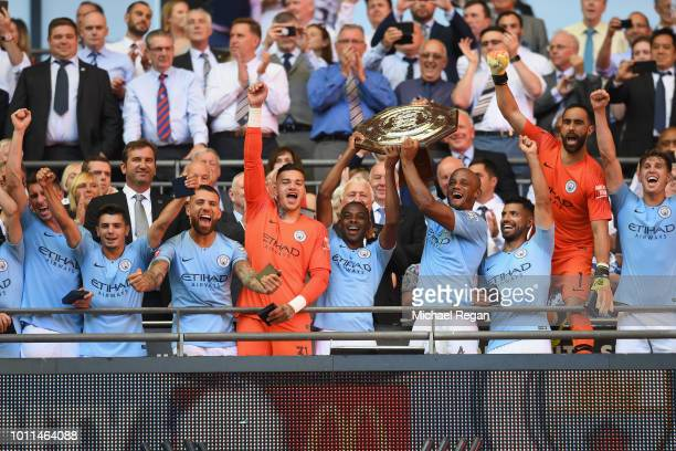 Vincent Kompany of Manchester City lifts the Community Shield trophy following his side's victory during the FA Community Shield between Manchester...