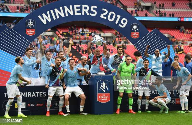 Vincent Kompany of Manchester City lifts the FA Cup Trophy following his team's victory in the FA Cup Final match between Manchester City and Watford...