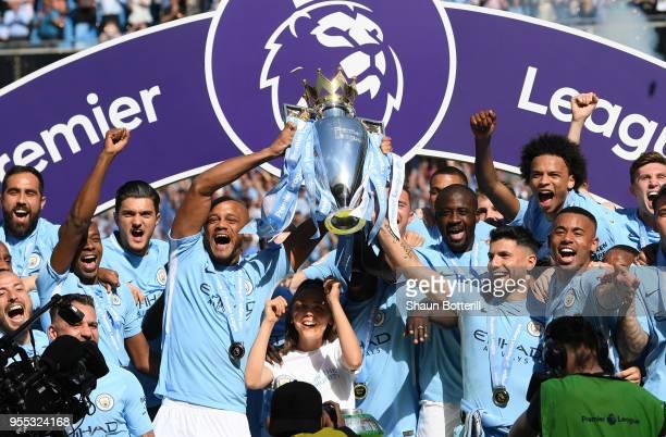 Vincent Kompany of Manchester City lifts the Premier League Trophy as Manchester City celebrate winning the Premier League after the Premier League...