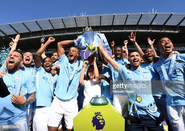 Vincent Kompany of Manchester City lifts the Premier League Trophy as Manchester City celebrate winning the Premier League after after the Premier...
