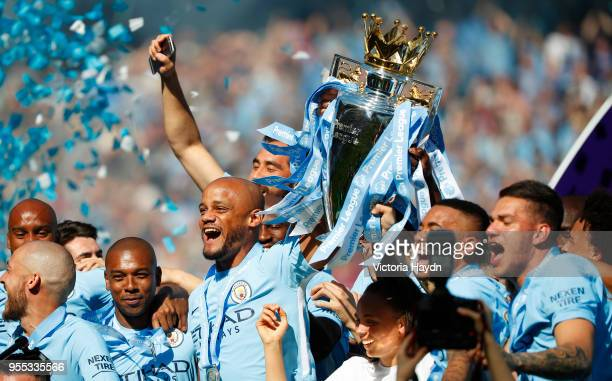 Vincent Kompany of Manchester City lifts the Premier League Trophy as Manchester City celebrate winning the Premier League after the Premier League...