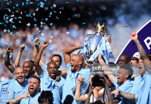 Vincent Kompany of Manchester City lifts the Premier League Trophy as Manchester City celebrate winning the Premier League Title during the Premier...