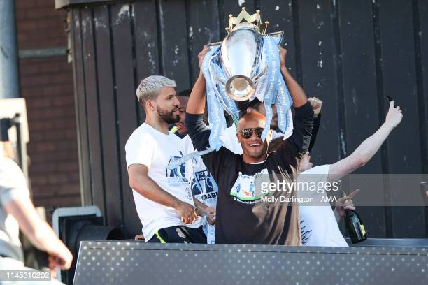 Vincent Kompany of Manchester City lifts the Premier League Trophy during the Manchester City trophy parade in Manchester on May 20 2019 in...