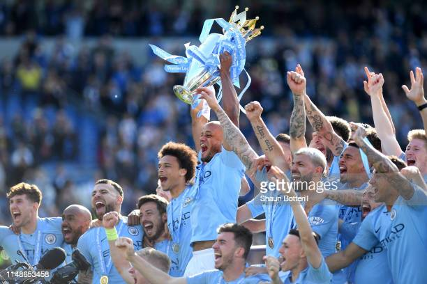 Vincent Kompany of Manchester City lifts the Premier League Trophy after winning the title during the Premier League match between Brighton & Hove...