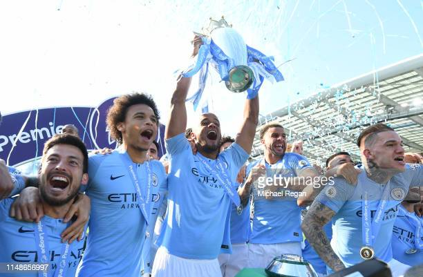 Vincent Kompany of Manchester City lifts the Premier League Trophy after winning the title during the Premier League match between Brighton Hove...