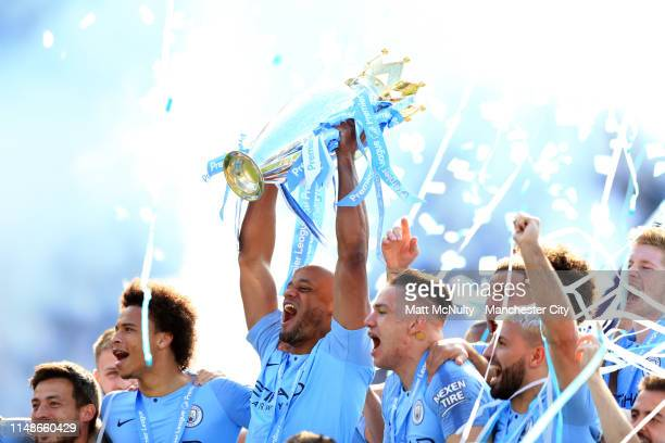 Vincent Kompany of Manchester City lifts the Premier League Trophy after winning the title following the Premier League match between Brighton Hove...