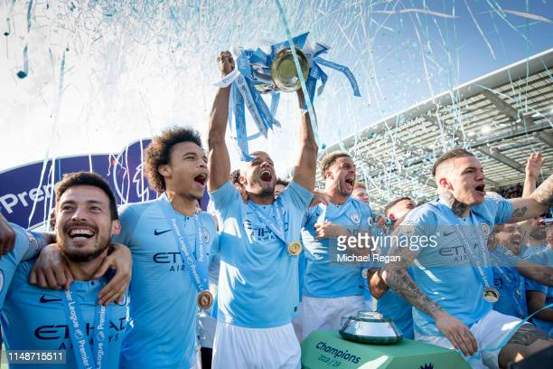 Vincent Kompany of Manchester City lifts the Premier League trophy after the Premier League match between Brighton Hove Albion and Manchester City at...