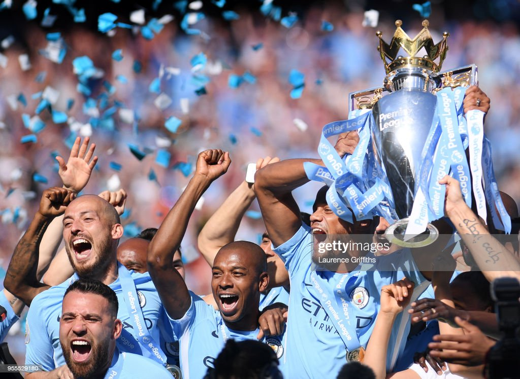 Vincent Kompany of Manchester City lifts the Premier League Trophy alongside David Silva, Nicolas Otamendi and Fernandinho as Manchester City celebrate winning the Premier League Title during the Premier League match between Manchester City and Huddersfield Town at Etihad Stadium on May 6, 2018 in Manchester, England.