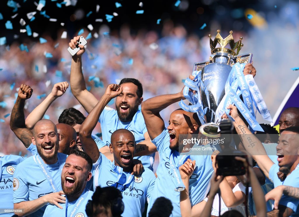https://media.gettyimages.com/photos/vincent-kompany-of-manchester-city-lifts-the-premier-league-trophy-picture-id955529398