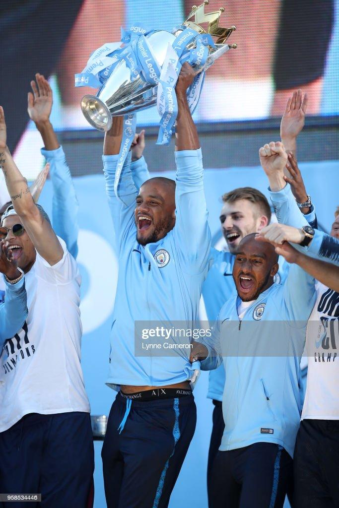 Vincent Kompany of Manchester City lifts the Premier League Trophy during the Manchester City Trophy Parade in Manchester city centre on May 14, 2018 in Manchester, England.