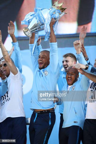 Vincent Kompany of Manchester City lifts the Premier League Trophy during the Manchester City Trophy Parade in Manchester city centre on May 14 2018...