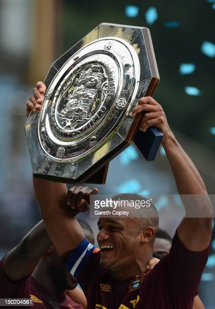 Vincent Kompany of Manchester City lifts the trophy after his team's victory at the end of the FA Community Shield match between Manchester City and...