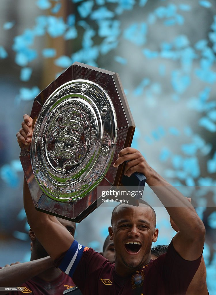 Vincent Kompany of Manchester City lifts the trophy after his team's victory at the end of the FA Community Shield match between Manchester City and Chelsea at Villa Park on August 12, 2012 in Birmingham, England.