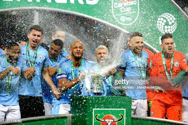 Vincent Kompany of Manchester City lifts the trophy after winning the Carabao Cup Final between Chelsea and Manchester City at Wembley Stadium on...