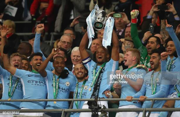 Vincent Kompany of Manchester City lifts the trophy after winning the Carabao Cup Final between Arsenal and Manchester City at Wembley Stadium on...