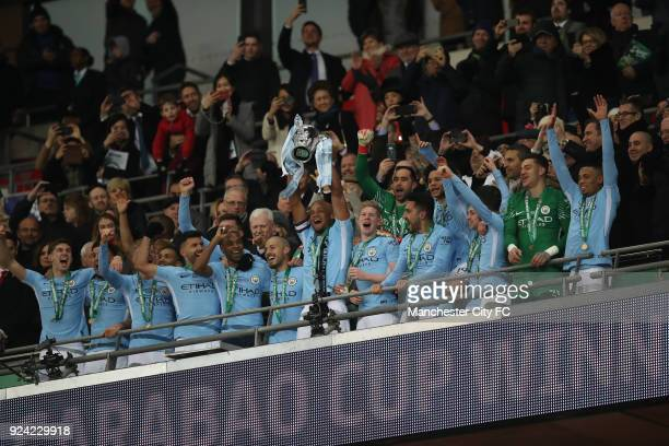 Vincent Kompany of Manchester City lifts the trophy and celebrates after the Carabao Cup Final between Arsenal and Manchester City at Wembley Stadium...