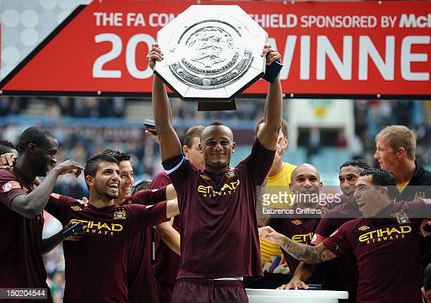 Vincent Kompany of Manchester City lifts the trophy during the FA Community Shield match between Manchester City and Chelsea at Villa Park on August...