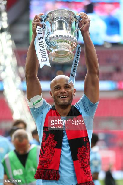 Vincent Kompany of Manchester City lifts the trophy following the FA Cup Final match between Manchester City and Watford at Wembley Stadium on May...