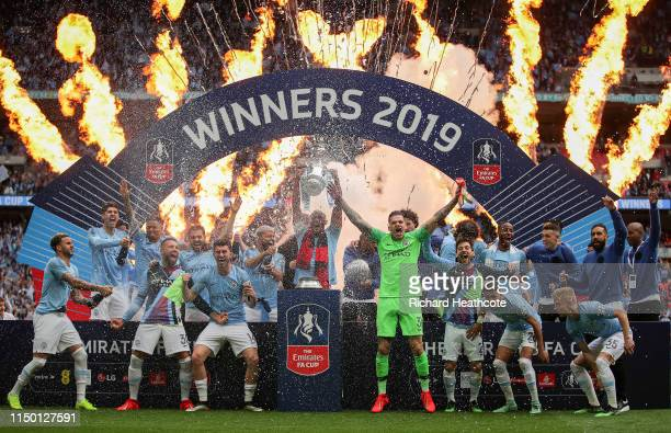 Vincent Kompany of Manchester City lifts the trophy following the FA Cup Final match between Manchester City and Watford at Wembley Stadium on May 18...
