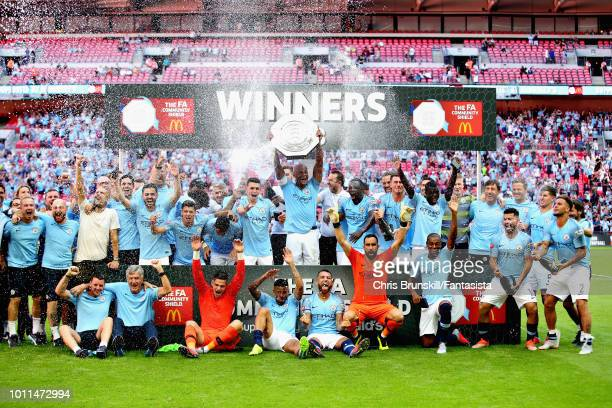 Vincent Kompany of Manchester City lifts the trophy with his team after winning the FA Community Shield match between Manchester City and Chelsea at...