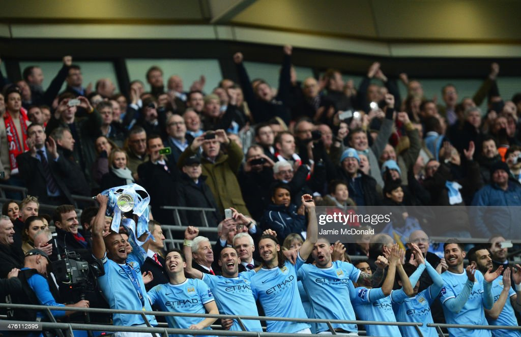 Vincent Kompany of Manchester City lifts the trophy with team mates after the Capital One Cup Final between Manchester City and Sunderland at Wembley Stadium on March 2, 2014 in London, England.