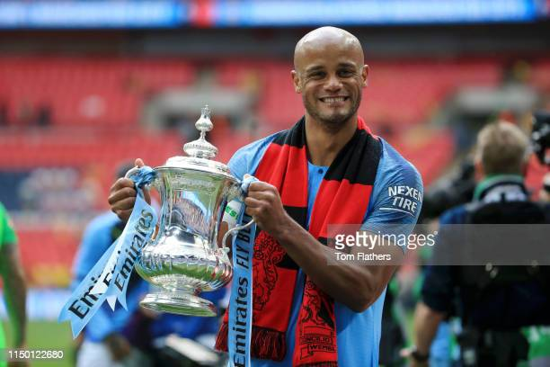 Vincent Kompany of Manchester City poses with the trophy after victory in the FA Cup Final match between Manchester City and Watford at Wembley...