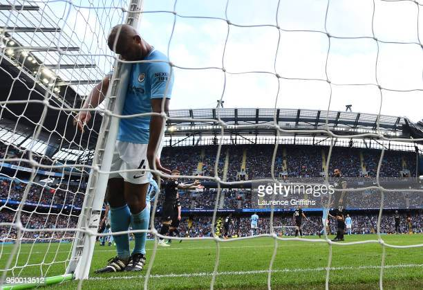 Vincent Kompany of Manchester City reacts following a missed chance during the Premier League match between Manchester City and Swansea City at...
