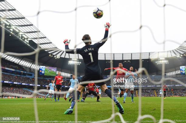 Vincent Kompany of Manchester City scores his side's first goal during the Premier League match between Manchester City and Manchester United at...